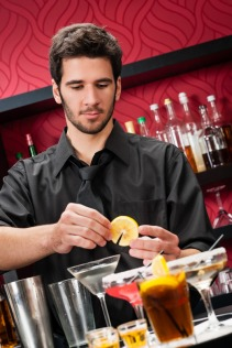 Young bartender make cocktail prepare drinks